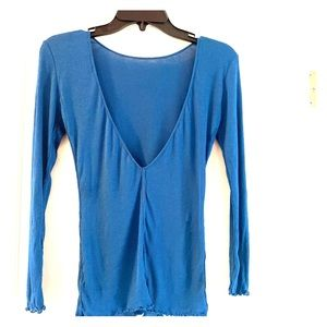 Never worn blue long sleeved shirt with open back.